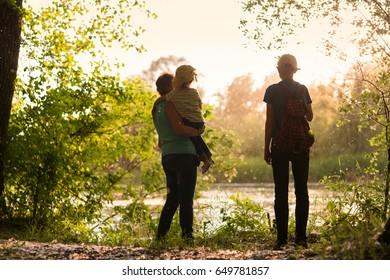 Grandmother with grandchildren walks in nature