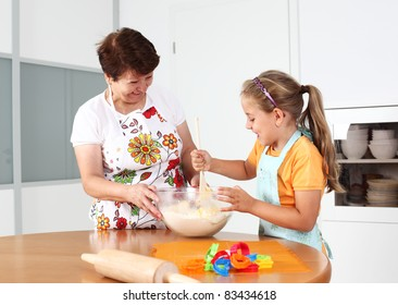 Grandmother and granddaughter baking and having fun together