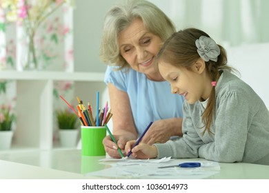 Grandmother with granddaughter drawing