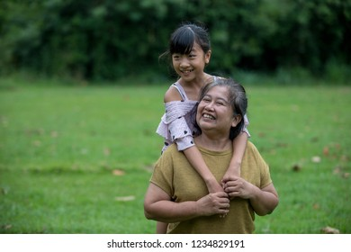 Grandmother and granddaughter enjoyed in the garden.