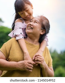 Grandmother and granddaughter enjoyed in the garden.Asian family conception