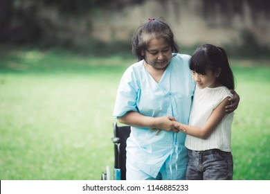 Grandmother and granddaughter enjoyed in the garden.Asian family conception.Insurance Concept