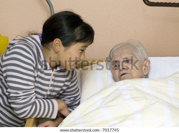 Grandmother and granddaughter at a nursing home.