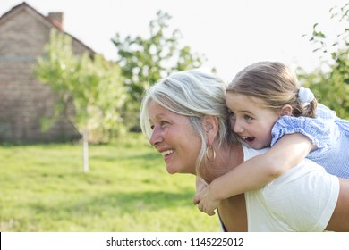 Grandmother and granddaughter are playing outdoor