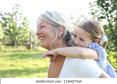 grandmother and granddaughter playing together outdoors