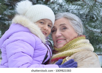 grandmother with granddaughter smiling