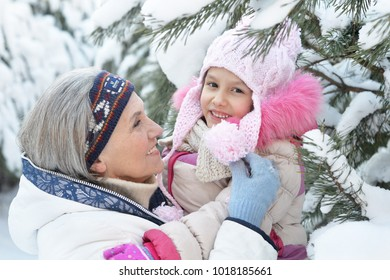 grandmother and granddaughter in winter