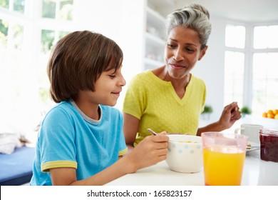 Grandmother And Grandson Having Breakfast Together
