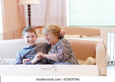 Grandmother with Grandson having fun together, they laugh and smile