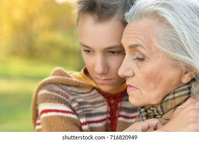 grandmother  and grandson hugging
