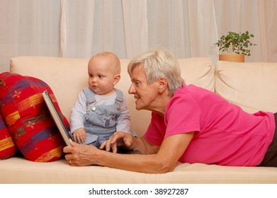 Grandmother with Grandson with laptop