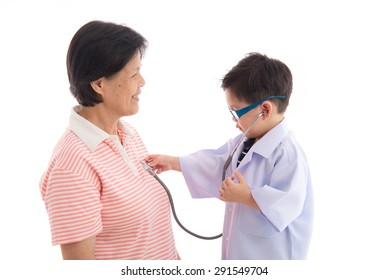 Grandmother and grandson playing as doctor and patient on white background isolated