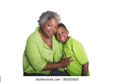 A grandmother and her grandson isolated on white