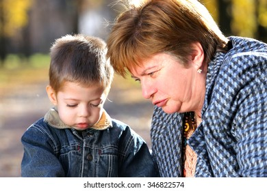 grandmother and her grandson in a park