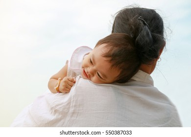 Grandmother holding her baby granddaughter