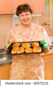 The grandmother with hot pies smiles