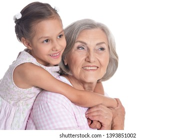 Grandmother hugging with her cute granddaughter isolated on white background