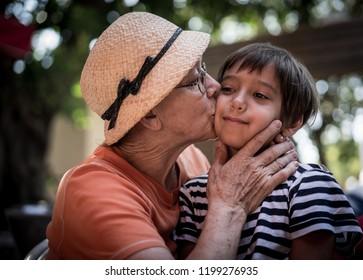 Grandmother hugging little boy