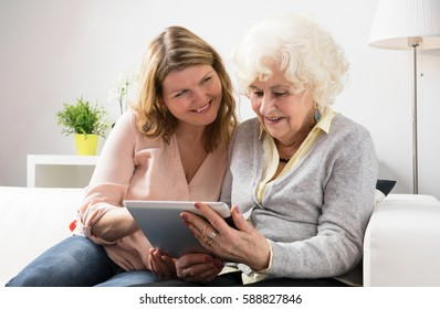 Grandmother learning how to use tablet
