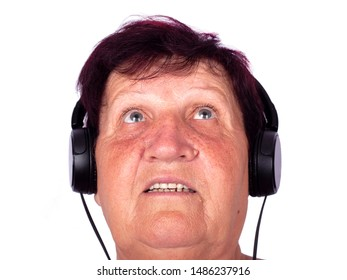 grandmother listens to psychedelic music on headphones,concept 60 year old grandma is listening to a song isolated