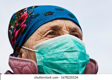 Grandmother in a medical mask close-up. Old woman with coronavirus. Coronavirus outbreak and precautions. Coronavirus epidemic regimen. Coronavirus emergency regimen