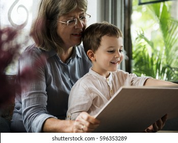 Grandmother and Nephew Relax Home Together