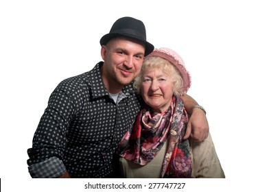 Grandmother in a pink hat and her grandson in a black  hat on a white background .