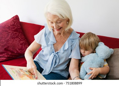A grandmother reading to her grandson