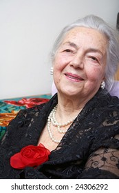 Grandmother with silk red rose