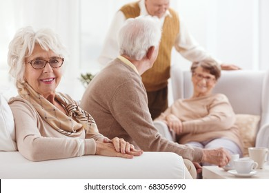 Grandmother sitting on a couch spending time with her family