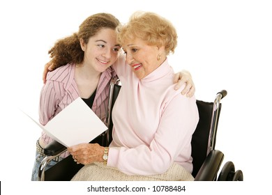 Grandmother and teen girl reading a get well card or mothers day card together.  Isolated on white.