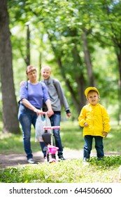 Grandmother is walking with her grandchildren in the park