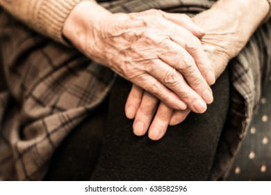 Grandmother's hands on the knee