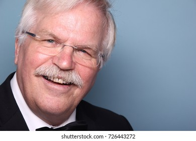 Grandpa in front of a colored background