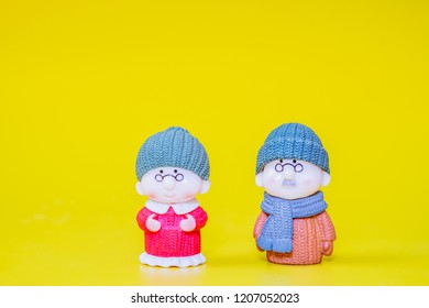 Grandpa and Grandma Dolls and yellow background