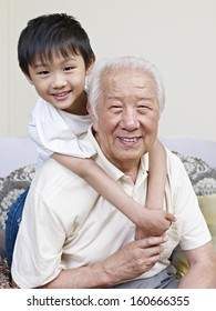grandpa and grandson having fun at home.