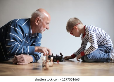 Grandpa and grandson playing together.