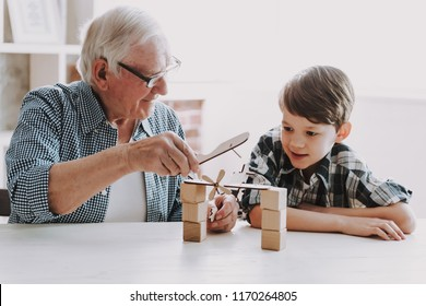 Grandpa and Grandson Playing with Toys at Home. Family Relationship Between Grandfather and Grandson. Grandpa Teaching, Male Grandchild, Learning Concept. Relations and People Concept.