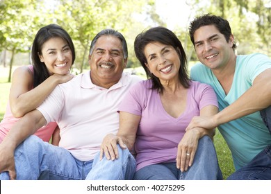 Grandparents With Adult Children In Park