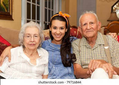 Grandparents with granddaughter in a home setting.