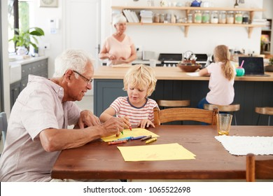 Grandparents and grandkids in family kitchen, close up