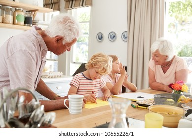 Grandparents and grandkids talking in the kitchen, close up