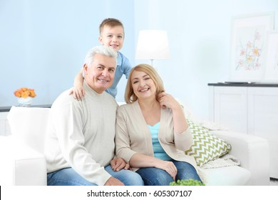 Grandparents with grandson on couch