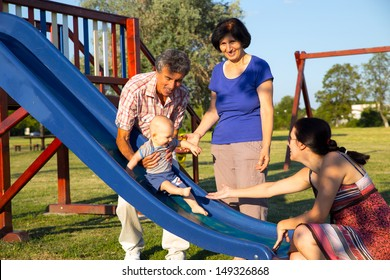 grandparents and her grandson playing