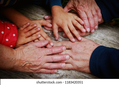 grandparents and kids hands, concept of family and parenting