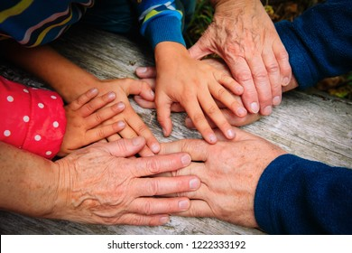 grandparents and kids hands, concept of family