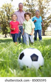 Grandparents playing football with grandchilderen