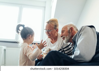 Grandparents spending time with their granddaughter