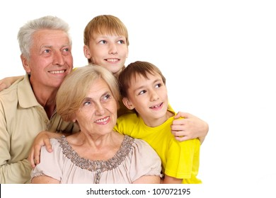 Grandparents with their grandchildren on a white background