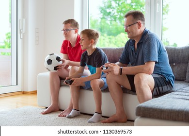 Grandparents, their son and grandson are watching world soccer championship and emotionally ill for the national team